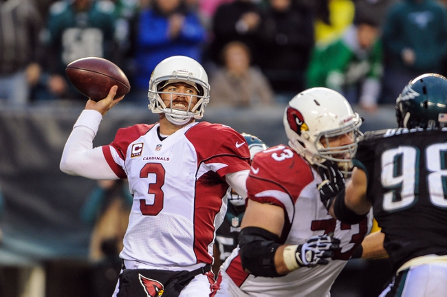 Dec 1, 2013; Philadelphia, PA, USA;  Arizona Cardinals quarterback Carson Palmer (3) passes in the fourth quarter of the game against the Philadelphia Eagles at Lincoln Financial Field. The Philadelphia Eagles won the game 24-21.  Mandatory Credit: John Geliebter-USA TODAY Sports