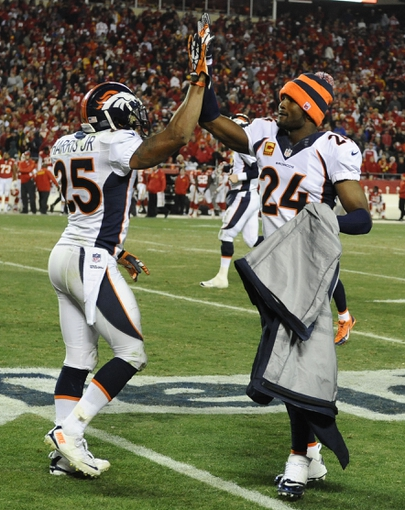Dec 1, 2013; Kansas City, MO, USA; Denver Broncos cornerback Champ Bailey (24) celebrates with cornerback Chris Harris (25) late in the game against the Kansas City Chiefs in the second half at Arrowhead Stadium. Denver won the game 35-28. Mandatory Credit: John Rieger-USA TODAY Sports