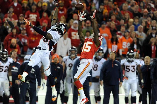 Dec 1, 2013; Kansas City, MO, USA; Kansas City Chiefs wide receiver A.J. Jenkins (15) catches a pass as Denver Broncos outside linebacker Von Miller (58) defends during the second half of the game at Arrowhead Stadium. Denver won 35-28. Mandatory Credit: Denny Medley-USA TODAY Sports