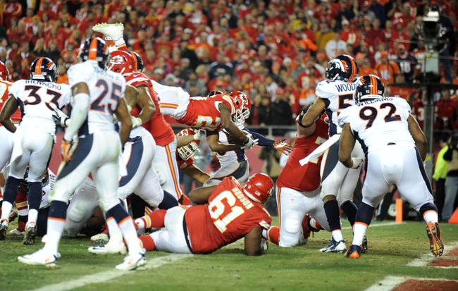 Dec 1, 2013; Kansas City, MO, USA; Kansas City Chiefs running back Jamaal Charles (25) scores a touchdown during the second half of the game against the Denver Broncos at Arrowhead Stadium. Denver won 35-28. Mandatory Credit: Denny Medley-USA TODAY Sports