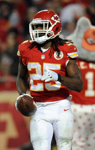 Dec 1, 2013; Kansas City, MO, USA; Kansas City Chiefs running back Jamaal Charles (25) celebrates after scoring a touchdown during the second half of the game against the Denver Broncos at Arrowhead Stadium. Denver won 35-28. Mandatory Credit: Denny Medley-USA TODAY Sports