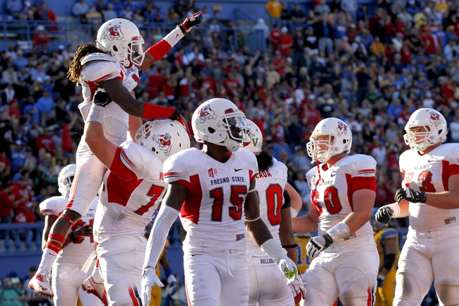 Nov 29, 2013; San Jose, CA, USA; Fresno State Bulldogs wide receiver Isaiah Burse (1) is congratulated by teammates after catching a touchdown pass against the San Jose State Spartans in the second quarter at Spartan Stadium. Mandatory Credit: Cary Edmondson-USA TODAY Sports