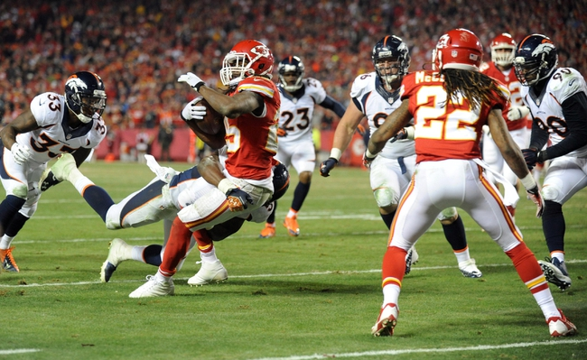 Dec 1, 2013; Kansas City, MO, USA; Kansas City Chiefs running back Jamaal Charles (25) is tackled by Denver Broncos outside linebacker Danny Trevathan (59) during the second half of the game at Arrowhead Stadium. Denver won 35-28. Mandatory Credit: Denny Medley-USA TODAY Sports