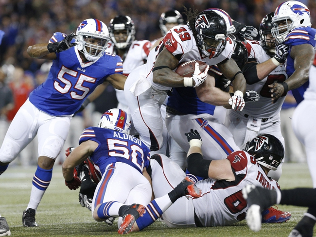 Dec 1, 2013; Toronto, ON, Canada; Atlanta Falcons running back Steven Jackson (39) is stopped near the goal line by the Buffalo Bills defense during the second half at the Rogers Center. Falcons beat the Bills 34-31. Mandatory Credit: Kevin Hoffman-USA TODAY Sports