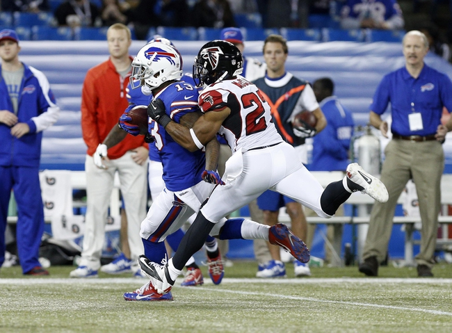 Dec 1, 2013; Toronto, ON, Canada; Buffalo Bills wide receiver Steve Johnson (13) runs after a catch as Atlanta Falcons cornerback Robert McClain (27) pursues during the second half at the Rogers Center. Falcons beat the Bills 34-31. Mandatory Credit: Kevin Hoffman-USA TODAY Sports