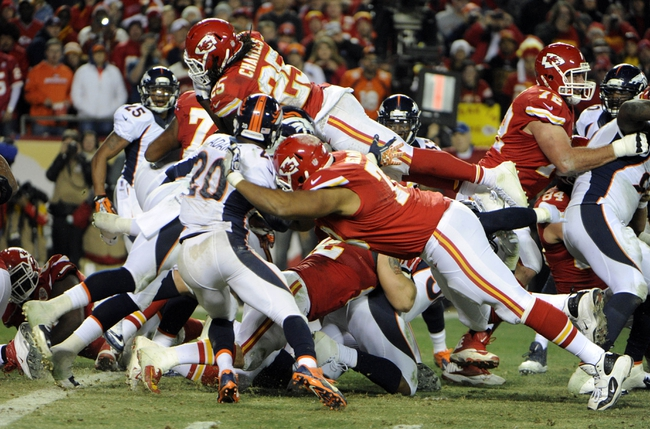 Dec 1, 2013; Kansas City, MO, USA; Kansas City Chiefs running back Jamaal Charles (25) jumps in for a touchdown against the Denver Broncos in the second half at Arrowhead Stadium. Denver won the game 35-28. Mandatory Credit: John Rieger-USA TODAY Sports