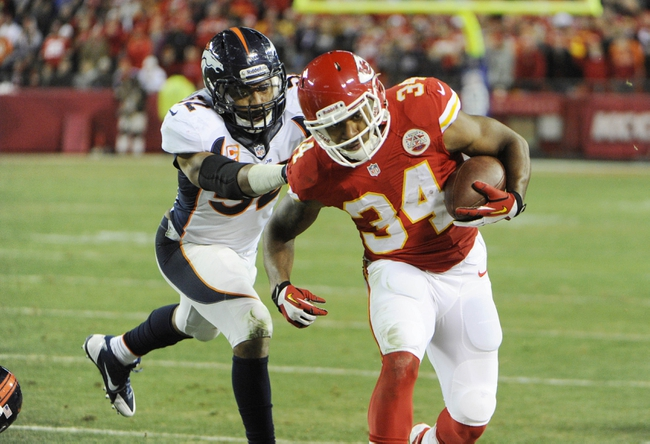 Dec 1, 2013; Kansas City, MO, USA; Kansas City Chiefs running back Knile Davis (34) is pushed out of bounds by Denver Broncos middle linebacker Wesley Woodyard (52) in the second half at Arrowhead Stadium. Denver won the game 35-28. Mandatory Credit: John Rieger-USA TODAY Sports