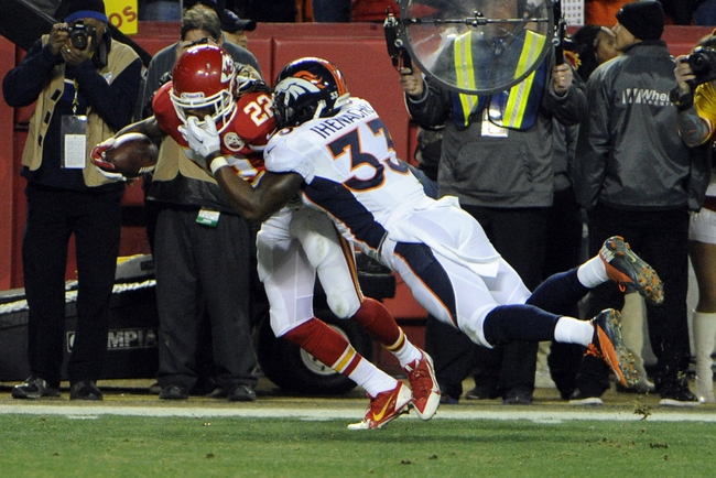 Dec 1, 2013; Kansas City, MO, USA; Denver Broncos strong safety Duke Ihenacho (33) is called for a face mask penalty against Kansas City Chiefs wide receiver Dexter McCluster (22) in the second half at Arrowhead Stadium. Denver won the game 35-28. Mandatory Credit: John Rieger-USA TODAY Sports