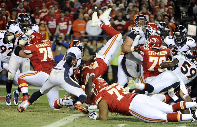 Dec 1, 2013; Kansas City, MO, USA; Kansas City Chiefs running back Jamaal Charles (25) dives in for a touchdown against the Denver Broncos in the second half at Arrowhead Stadium. Denver won the game 35-28. Mandatory Credit: John Rieger-USA TODAY Sports