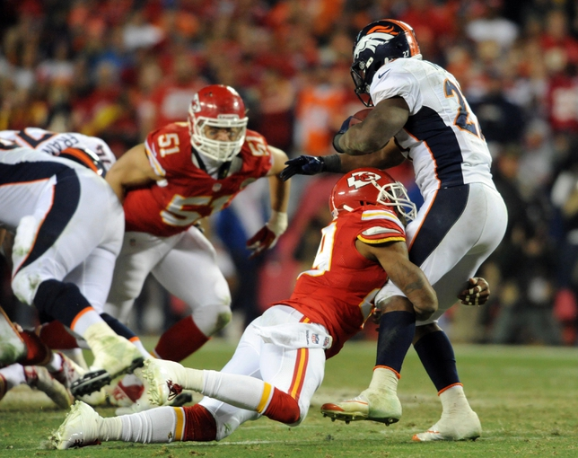 Dec 1, 2013; Kansas City, MO, USA; Denver Broncos running back Knowshon Moreno (27) is tackled by Kansas City Chiefs strong safety Eric Berry (29) during the second half of the game at Arrowhead Stadium. Denver won 35-28. Mandatory Credit: Denny Medley-USA TODAY Sports