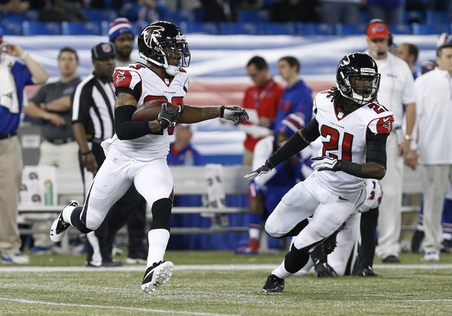 Dec 1, 2013; Toronto, ON, Canada; Atlanta Falcons cornerback Robert Alford (23) runs with the ball after recovering a Buffalo Bills fumble during overtime at the Rogers Center. Falcons beat the Bills 34-31. Mandatory Credit: Kevin Hoffman-USA TODAY Sports