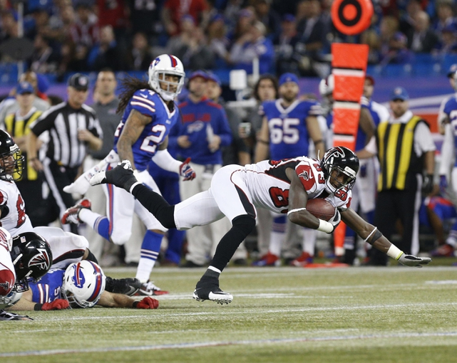 Dec 1, 2013; Toronto, ON, Canada; Atlanta Falcons wide receiver Harry Douglas (83) makes a catch against the Buffalo Bills during overtime at the Rogers Center. Falcons beat the Bills 34-31. Mandatory Credit: Kevin Hoffman-USA TODAY Sports