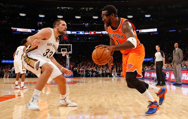 Dec 1, 2013; New York, NY, USA;  New York Knicks power forward Amar'e Stoudemire (1) drives around New Orleans Pelicans power forward Ryan Anderson (33) during the second quarter at Madison Square Garden. Mandatory Credit: Anthony Gruppuso-USA TODAY Sports