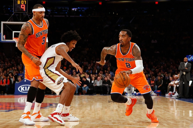 Dec 1, 2013; New York, NY, USA;  New York Knicks shooting guard J.R. Smith (8) drives around New Orleans Pelicans small forward Josh Childress (8) during the first quarter at Madison Square Garden. Mandatory Credit: Anthony Gruppuso-USA TODAY Sports