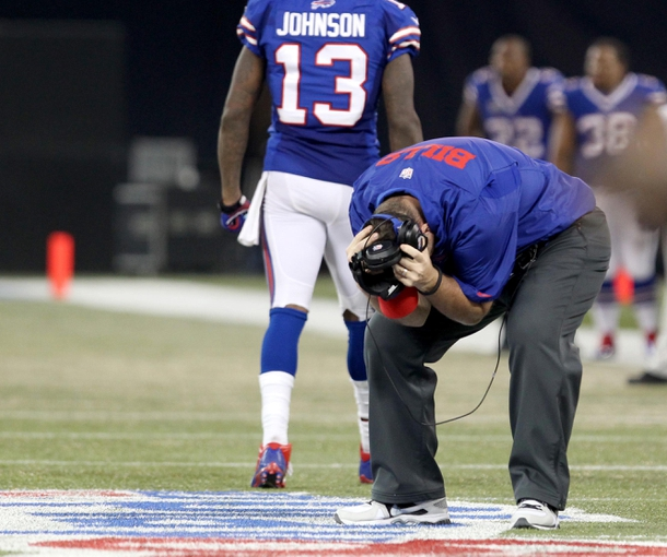 Dec 1, 2013; Toronto, ON, Canada; Buffalo Bills head coach Doug Marrone reacts after a penalty is called against his team during the second half against the Atlanta Falcons at the Rogers Center. Falcons beat the Bills 34 to 31 in overtime.  Mandatory Credit: Timothy T. Ludwig-USA TODAY Sports