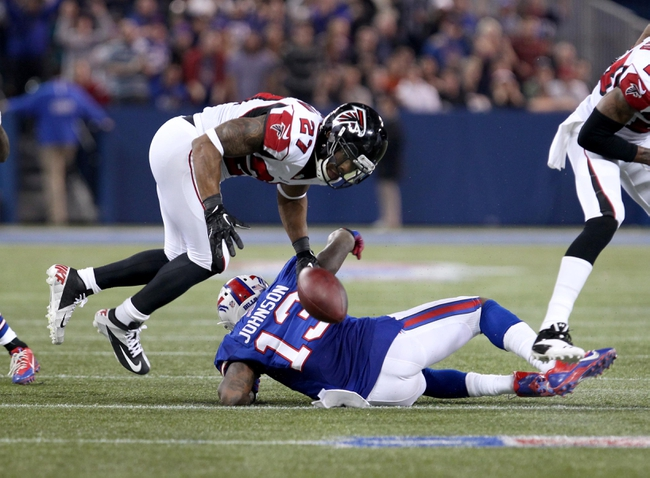 Dec 1, 2013; Toronto, ON, Canada; Atlanta Falcons cornerback Robert McClain (27) tries to tackle Buffalo Bills wide receiver Steve Johnson (13) and forces a fumble during the second half at the Rogers Center. Falcons beat the Bills 34 to 31 in overtime.  Mandatory Credit: Timothy T. Ludwig-USA TODAY Sports