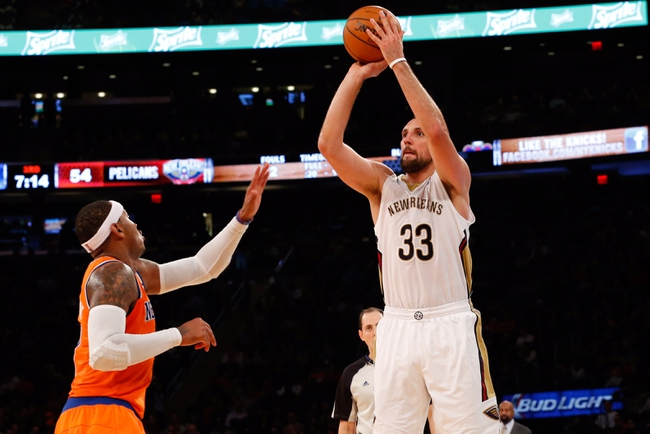 Dec 1, 2013; New York, NY, USA;  New Orleans Pelicans power forward Ryan Anderson (33) shoots over New York Knicks small forward Carmelo Anthony (7) during the third quarter at Madison Square Garden. New Orleans Pelicans won 103-99.  Mandatory Credit: Anthony Gruppuso-USA TODAY Sports