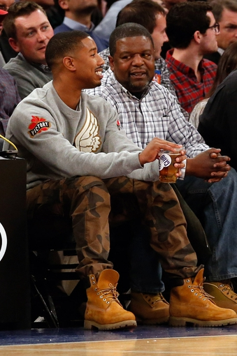 Dec 1, 2013; New York, NY, USA;  American actor Michael B Jordan (left) at the game between the New York Knicks and the New Orleans Pelicans at Madison Square Garden. New Orleans Pelicans won 103-99.  Mandatory Credit: Anthony Gruppuso-USA TODAY Sports