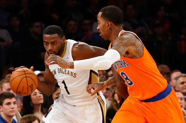 Dec 1, 2013; New York, NY, USA;  New Orleans Pelicans point guard Tyreke Evans (1) drives past New York Knicks shooting guard J.R. Smith (8) during the fourth quarter at Madison Square Garden. New Orleans Pelicans won 103-99.  Mandatory Credit: Anthony Gruppuso-USA TODAY Sports
