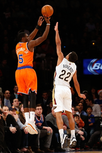 Dec 1, 2013; New York, NY, USA;  New York Knicks shooting guard Tim Hardaway Jr. (5) shoots for three over New Orleans Pelicans point guard Brian Roberts (22) during the fourth quarter at Madison Square Garden. New Orleans Pelicans won 103-99.  Mandatory Credit: Anthony Gruppuso-USA TODAY Sports