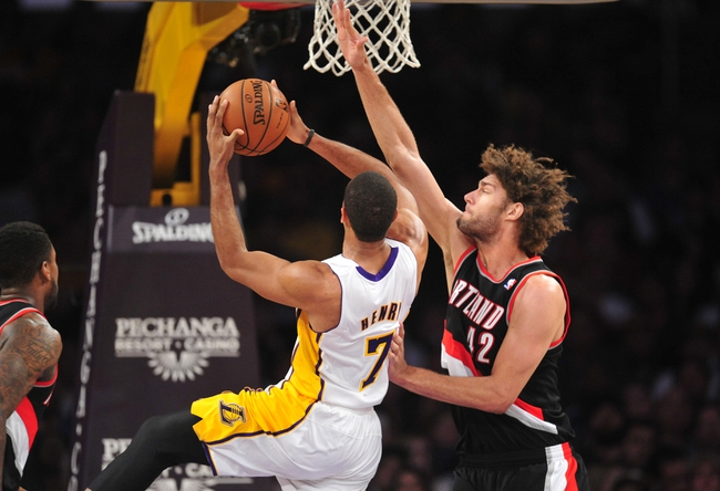 December 1, 2013; Los Angeles, CA, USA; Portland Trail Blazers center Robin Lopez (42) defends against Los Angeles Lakers small forward Xavier Henry (7) during the first half at Staples Center. Mandatory Credit: Gary A. Vasquez-USA TODAY Sports