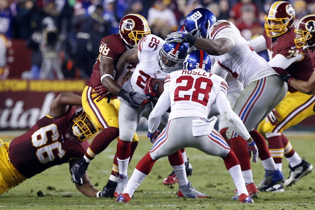 Dec 1, 2013; Landover, MD, USA;  New York Giants free safety Will Hill (25) strips the ball from Washington Redskins wide receiver Pierre Garcon (88) in the fourth quarter at FedEx Field. The Giants won 24-17. Mandatory Credit: Geoff Burke-USA TODAY Sports