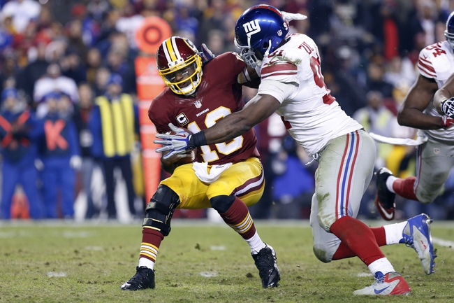 Dec 1, 2013; Landover, MD, USA;  Washington Redskins quarterback Robert Griffin III (10) is sacked by New York Giants defensive end Justin Tuck (91) in the fourth quarter at FedEx Field. The Giants won 24-17. Mandatory Credit: Geoff Burke-USA TODAY Sports