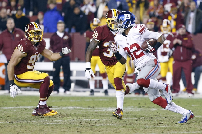Dec 1, 2013; Landover, MD, USA;  New York Giants wide receiver Rueben Randle (82) runs with the ball as Washington Redskins free safety David Amerson (39) and Redskins outside linebacker Ryan Kerrigan (91) chase in the fourth quarter at FedEx Field. The Giants won 24-17. Mandatory Credit: Geoff Burke-USA TODAY Sports