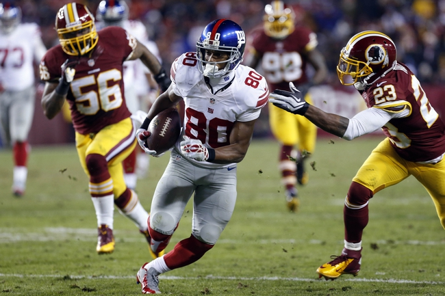 Dec 1, 2013; Landover, MD, USA;  New York Giants wide receiver Victor Cruz (80) runs with the ball as Washington Redskins cornerback DeAngelo Hall (23) chases in the fourth quarter at FedEx Field. The Giants won 24-17. Mandatory Credit: Geoff Burke-USA TODAY Sports