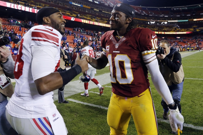 Dec 1, 2013; Landover, MD, USA; New York Giants wide receiver Hakeem Nicks (88) shakes hands with Washington Redskins quarterback Robert Griffin III (10) after their game at FedEx Field. The Giants won 24-17. Mandatory Credit: Geoff Burke-USA TODAY Sports