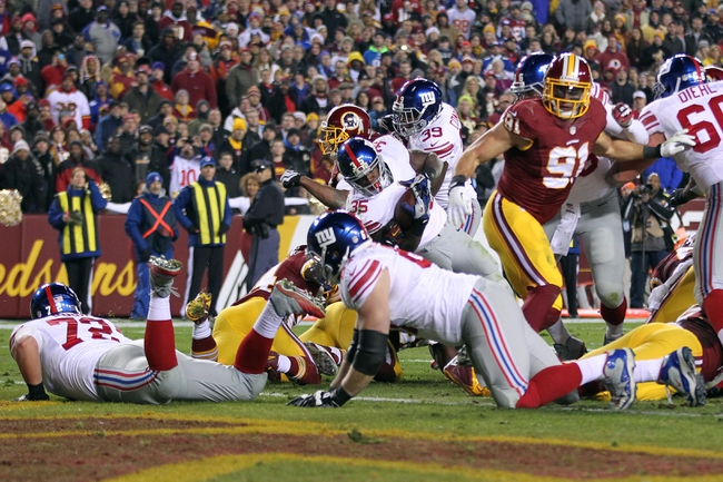 Dec 1, 2013; Landover, MD, USA; New York Giants running back Andre Brown (35) scores a touchdown against the Washington Redskins in the fourth quarter at FedEx Field. The Giants won 24-17. Mandatory Credit: Geoff Burke-USA TODAY Sports