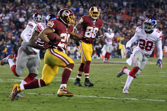 Dec 1, 2013; Landover, MD, USA; Washington Redskins running back Roy Helu (29) carries the ball as New York Giants free safety Will Hill (25) and Giants cornerback Jayron Hosley (28) chase in the fourth quarter at FedEx Field. The Giants won 24-17. Mandatory Credit: Geoff Burke-USA TODAY Sports