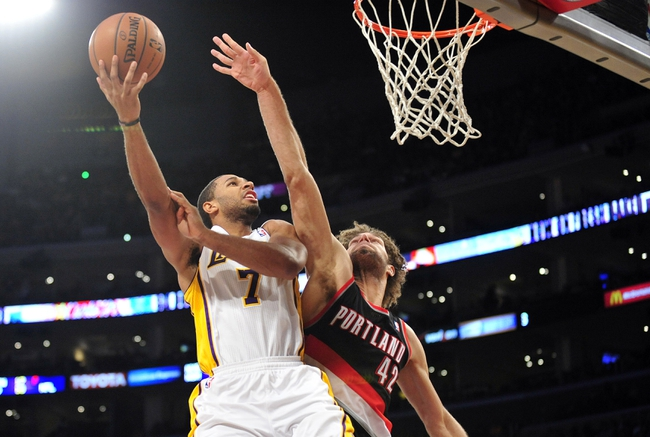 December 1, 2013; Los Angeles, CA, USA; Los Angeles Lakers small forward Xavier Henry (7) moves to the basket against the defense of Portland Trail Blazers center Robin Lopez (42) during the second half at Staples Center. Mandatory Credit: Gary A. Vasquez-USA TODAY Sports