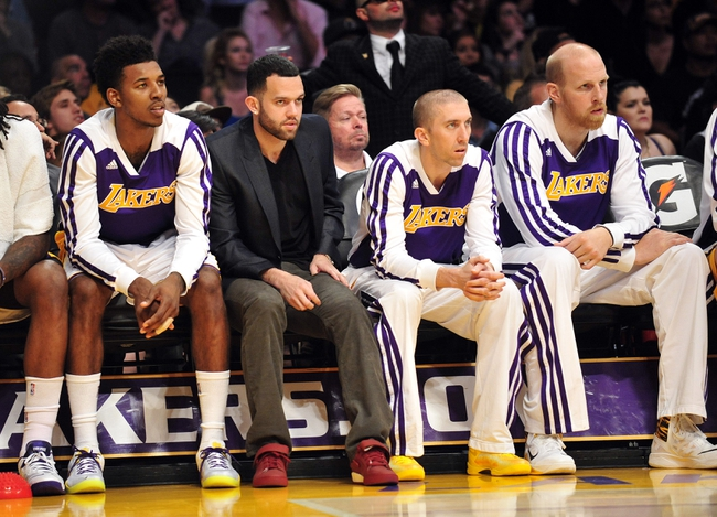 December 1, 2013; Los Angeles, CA, USA; Los Angeles Lakers point guard Jordan Farmar (1) watches game action after suffering an apparent injury and being pulled in the first half against the Portland Trail Blazers at Staples Center. Mandatory Credit: Gary A. Vasquez-USA TODAY Sports