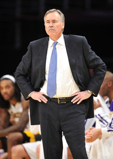 December 1, 2013; Los Angeles, CA, USA; Los Angeles Lakers head coach Mike D'Antoni watches game action against the Portland Trail Blazers during the second half at Staples Center. Mandatory Credit: Gary A. Vasquez-USA TODAY Sports