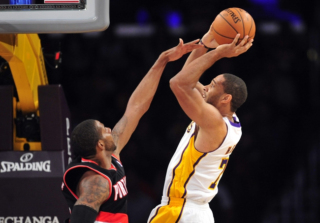 December 1, 2013; Los Angeles, CA, USA; Los Angeles Lakers small forward Xavier Henry (7) shoots a basket against the Portland Trail Blazers during the second half at Staples Center. Mandatory Credit: Gary A. Vasquez-USA TODAY Sports