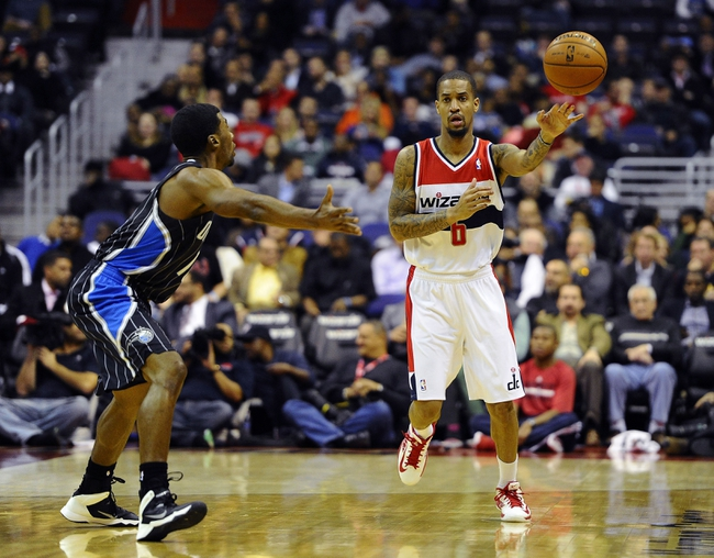 Dec 2, 2013; Washington, DC, USA; Washington Wizards point guard Eric Maynor (6) passes the ball as Orlando Magic point guard Ronnie Price (10) defends during the first half at the Verizon Center. Mandatory Credit: Brad Mills-USA TODAY Sports
