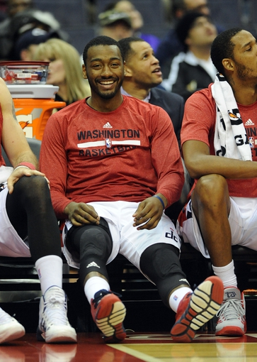 Dec 2, 2013; Washington, DC, USA; Washington Wizards point guard John Wall (2) sits on the bench against the Orlando Magic during the second half at the Verizon Center. The Wizards defeated the Magic 98 - 80. Mandatory Credit: Brad Mills-USA TODAY Sports
