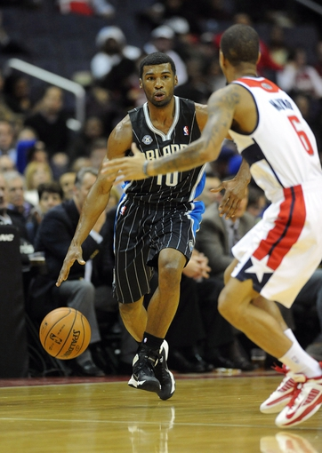 Dec 2, 2013; Washington, DC, USA; Orlando Magic point guard Ronnie Price (10) dribbles the ball as Washington Wizards point guard Eric Maynor (6) defends during the second half at the Verizon Center. The Wizards defeated the Magic 98 - 80. Mandatory Credit: Brad Mills-USA TODAY Sports