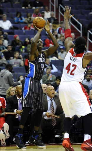 Dec 2, 2013; Washington, DC, USA; Orlando Magic power forward Andrew Nicholson (44) attempts a jump shot over Washington Wizards power forward Nene Hilario (42) during the second half at the Verizon Center. The Wizards defeated the Magic 98 - 80. Mandatory Credit: Brad Mills-USA TODAY Sports