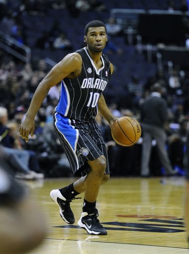 Dec 2, 2013; Washington, DC, USA; Orlando Magic point guard Ronnie Price (10) dribbles the ball against the Washington Wizards during the second half at the Verizon Center. The Wizards defeated the Magic 98 - 80. Mandatory Credit: Brad Mills-USA TODAY Sports