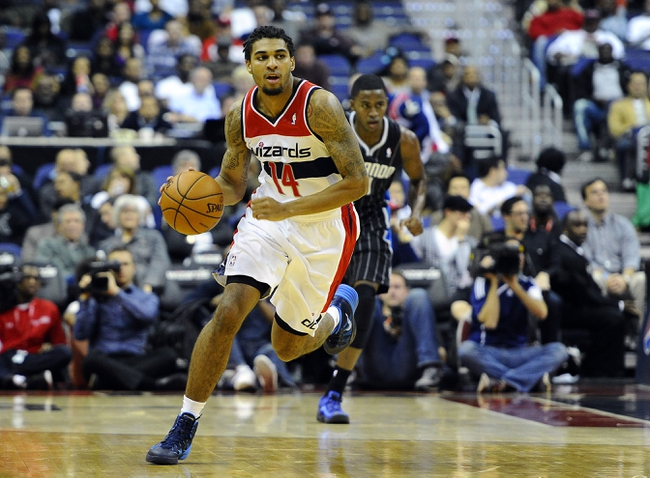 Dec 2, 2013; Washington, DC, USA; Washington Wizards shooting guard Glen Rice Jr. (14) brings the ball up court against the Orlando Magic during the second half at the Verizon Center. The Wizards defeated the Magic 98 - 80. Mandatory Credit: Brad Mills-USA TODAY Sports