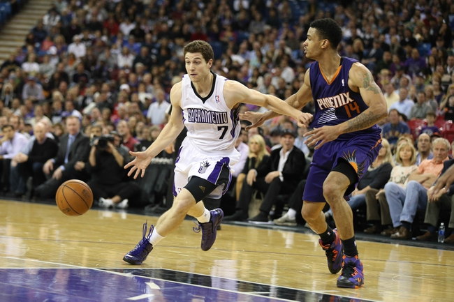 Nov 19, 2013; Sacramento, CA, USA; Sacramento Kings point guard Jimmer Fredette (7) drives in against Phoenix Suns shooting guard Gerald Green (14) during the fourth quarter at Sleep Train Arena. The Sacramento Kings defeated the Phoenix Suns 107-104. Mandatory Credit: Kelley L Cox-USA TODAY Sports