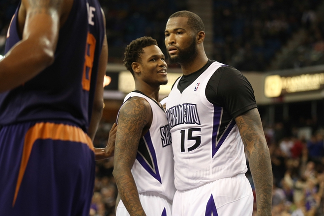 Nov 19, 2013; Sacramento, CA, USA; Sacramento Kings shooting guard Ben McLemore (16) chest bumps with center DeMarcus Cousins (15) after a foul by the Phoenix Suns during the fourth quarter at Sleep Train Arena. The Sacramento Kings defeated the Phoenix Suns 107-104. Mandatory Credit: Kelley L Cox-USA TODAY Sports