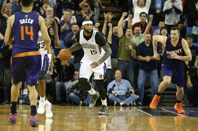 Nov 19, 2013; Sacramento, CA, USA; Sacramento Kings center DeMarcus Cousins (15) controls the ball against the Phoenix Suns during the fourth quarter at Sleep Train Arena. The Sacramento Kings defeated the Phoenix Suns 107-104. Mandatory Credit: Kelley L Cox-USA TODAY Sports