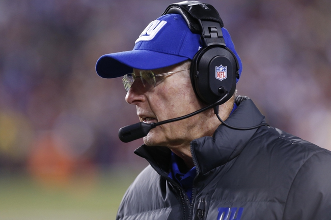 Dec 1, 2013; Landover, MD, USA; New York Giants head coach Tom Coughlin watches from the sidelines against the Washington Redskins in the third quarter at FedEx Field. The Giants won 24-17. Mandatory Credit: Geoff Burke-USA TODAY Sports