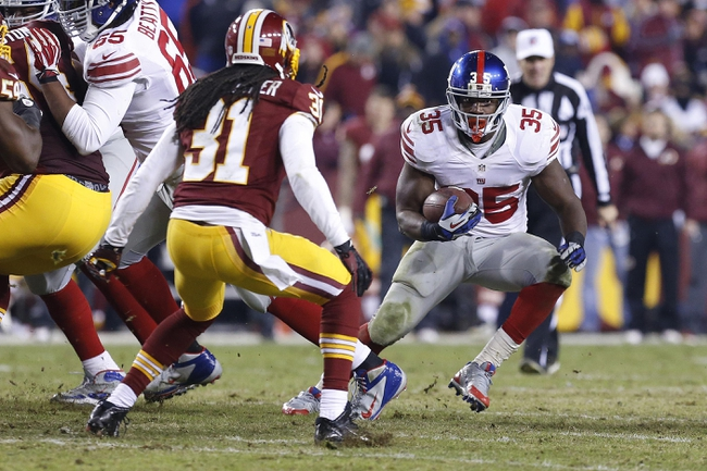 Dec 1, 2013; Landover, MD, USA; New York Giants running back Andre Brown (35) carries the ball as Washington Redskins strong safety Brandon Meriweather (31) chases in the fourth quarter at FedEx Field. The Giants won 24-17. Mandatory Credit: Geoff Burke-USA TODAY Sports