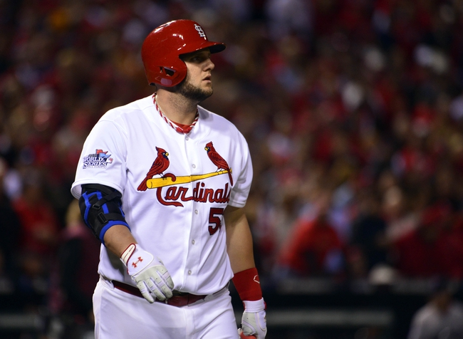 Oct 28, 2013; St. Louis, MO, USA; St. Louis Cardinals pinch hitter Matt Adams reacts after striking out against the Boston Red Sox in the 8th inning during game five of the MLB baseball World Series at Busch Stadium. Mandatory Credit: Scott Rovak-USA TODAY Sports