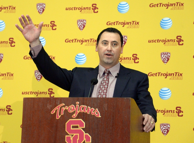 Dec 3, 2013; Los Angeles, CA, USA; Steve Sarkisian waves to the crowd at a press conference to announce his hiring as Southern California Trojans football coach at John McKay Center. Mandatory Credit: Kirby Lee-USA TODAY Sports