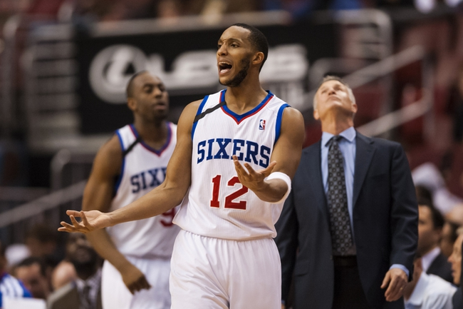 Dec 3, 2013; Philadelphia, PA, USA; Philadelphia 76ers guard Evan Turner (12) reacts to fouling out during the second overtime period against the Orlando Magic at the Wells Fargo Center. The Sixers defeated the Magic 126-125 in double overtime. Mandatory Credit: Howard Smith-USA TODAY Sports
